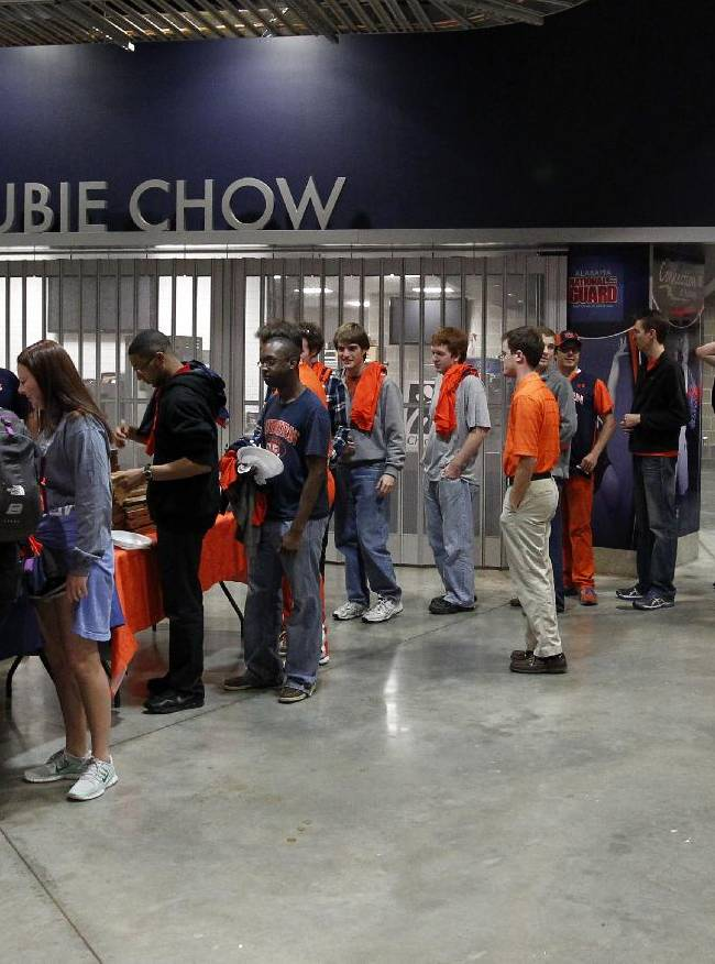 Auburn students line up around the arena for pizza paid for by Auburn's new men's basketball coach, Bruce Pearl, on Tuesday, March 18, 2014, in Auburn, Ala