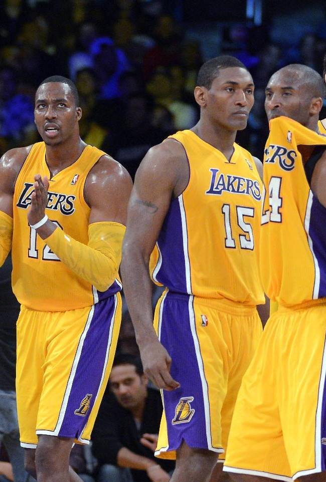In this Oct. 21, 2012, file photo, Los Angeles Lakers, from left, Steve Nash, Dwight Howard, Metta World Peace, Kobe Bryant and Pau Gasol, of Spain, pause during the second half of a preseason NBA basketball game against the Sacramento Kings in Los Angeles. Just three years removed from their last championship, the Lakers are a team in transition