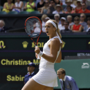Sabine Lisicki of Germany celebrates winning the singles match against Christina McHale of the United States, during their singles match at the All England Lawn Tennis Championships in Wimbledon, London, Thursday July 2, 2015. (AP Photo/Pavel Golovkin)