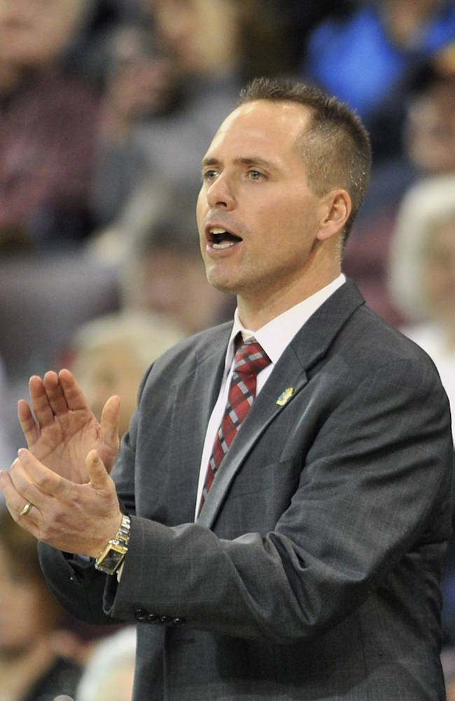 West Texas A&M coach Mark Kellogg applauds during the first half against Nova Southeastern in an NCAA women's Division II basketball tournament semifinal in Erie, Pa., on Wednesday, March 26, 2014