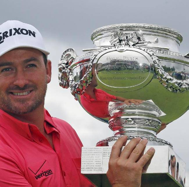 Graeme McDowell of Northern Ireland poses with his trophy after winning the French Open Golf tournament at Paris National course in Guyancourt, west of Paris, France, Sunday, July 6, 2014
