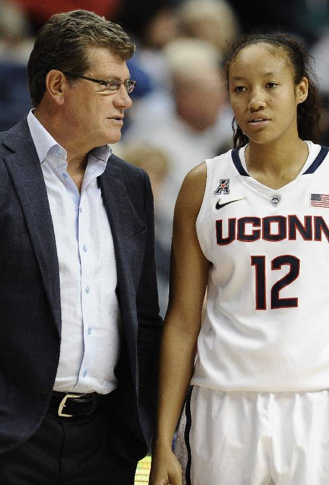 Connecticut coach Geno Auriemma, left, speaks with freshman Saniya Chong during the second half of an NCAA college exhibition basketball game against Gannon, Friday, Nov. 1, 2013, in Storrs, Conn. Connecticut won 101-35