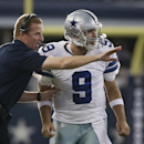 Dallas Cowboys head coach Jason Garrett instructs Tony Romo (9) during the second half of an NFL football game against the New York Giants, Sunday, Oct. 19, 2014, in Arlington, Texas The Associated Press