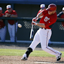 Washington Nationals' Mike Fontenot hits a three-RBI double in the sixth inning of a spring exhibition baseball game against the Atlanta Braves, Saturday, March 1, 2014, in Viera, Fla. The Nationals won 16-15 The Associated Press
