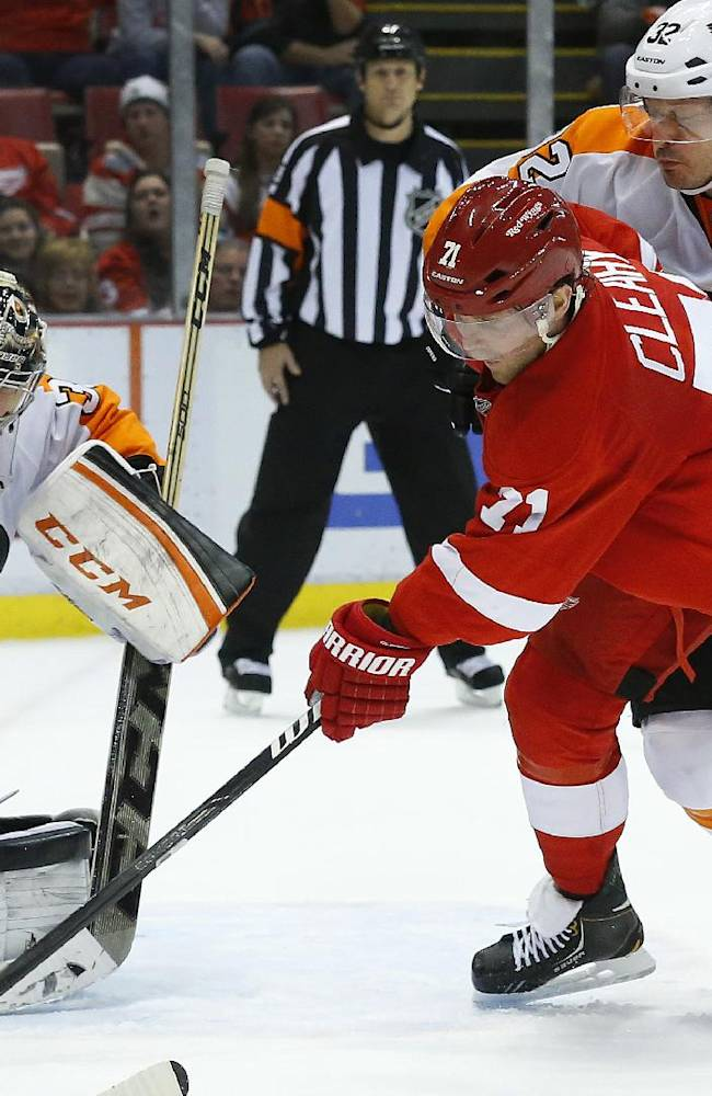 Philadelphia Flyers goalie Steve Mason (35) stops a Detroit Red Wings right wing Daniel Cleary (71) shot as defenseman Mark Streit (32), of Switzerland, efends in the second period of an NHL hockey game in Detroit, Wednesday, Dec. 4, 2013