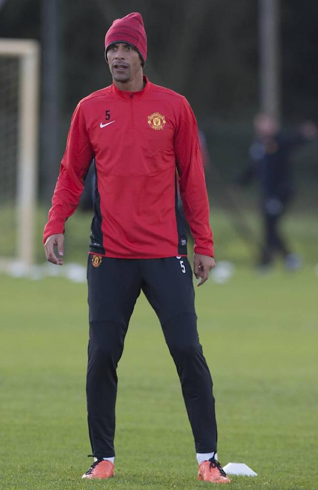 Manchester United's Rio Ferdinand trains with teammates at Carrington training ground, in Manchester, England, Monday, Sept. 16, 2013. Manchester United will play Bayer Leverkusen in a Champion's League Group A soccer match on Tuesday