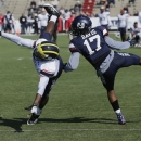 Senior Bowl North Squad wide receiver Denard Robinson of Michigan (16) is guarded by defensive back Will Davis of Utah State (17) as he tries to make a catch during Senior Bowl football practice at Ladd-Peebles Stadium in Mobile, Ala., Wednesday, Jan. 23, 2013.(AP Photo/Dave Martin)