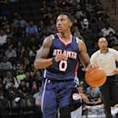 SAN ANTONIO, TX - OCTOBER 22: Jeff Teague #0 of the Atlanta Hawks handles the ball against the San Antonio Spurs at the AT&T Center on October 22, 2014 in San Antonio, Texas
