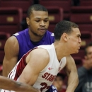 Stanford's Dwight Powell, front, drives for the basket as Stephen F. Austin's Taylor Smith defends during the first half of a first round NIT college basketball game, Tuesday, March 19, 2013 in Stanford, Calif. (AP Photo/George Nikitin)