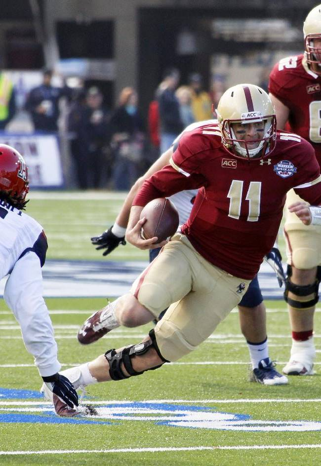 Boston College quarterback Chase Rettig (11) rushes for short yards as Arizona cornerback Jonathan McKnight (6) defends during the first half of the AdvoCare V100 Bowl NCAA college football game, Tuesday, Dec. 31, 2013, at Independence Stadium in Shreveport, La