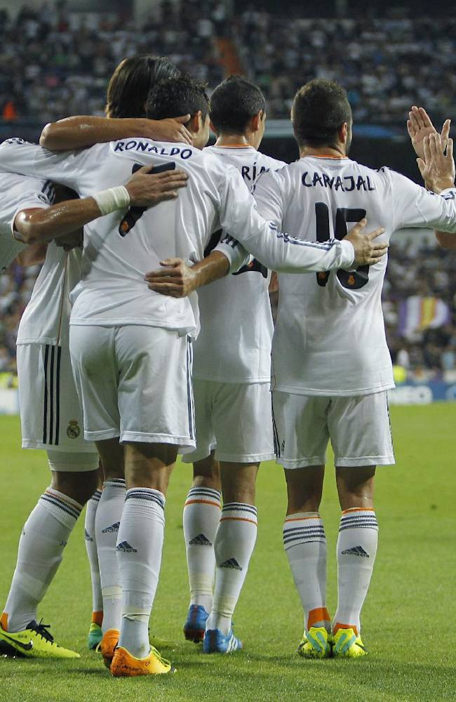 Real Madrid's Cristiano Ronaldo from Portugal, third left, celebrates his goal with Karim Benzema from France, right, and team mates during the Champions League group B soccer match between Real Madrid and FC Copenhagen at the Santiago Bernabeu stadium in Madrid, Spain, Wednesday, Oct. 2, 2013