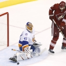 New York Islanders' Jaroslav Halak (41) makes a save on a redirected shot by Arizona Coyotes' Martin Hanzal (11), of the Czech Republic, during the second period of an NHL hockey game Saturday, Nov. 8, 2014, in Glendale, Ariz. The Islanders defeated Coyot