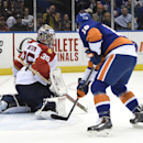 New York Islanders center Ryan Strome (18) watches the puck shot by center Anders Lee fly past the back of Florida Panthers goalie Al Montoya (35) to score in the second period of an NHL hockey game at Nassau Coliseum on Tuesday, Feb. 3, 2015, in Uniondal
