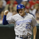Kansas City Royals' Elliot Johnson celebrates after scoring from third base on a wild pitch from Cleveland Indians relief pitcher Matt Albers in the ninth inning of a baseball game Monday, June 17, 2013, in Cleveland. (AP Photo/Mark Duncan)