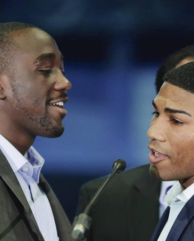 Terence Crawford, left, and Yuriorkis Gamboa exchange verbal jabs at a news conference in Omaha, Neb., Thursday, May 8, 2014, to announce their world lightweight championship fight in June. Crawford will defend his WBO title in his hometown in the first world championship fight in Omaha, since Joe Frazier stopped Ron Stander in 1972