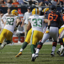 Green Bay Packers outside linebacker Clay Matthews (52) runs after intercepting a pass thrown by Chicago Bears quarterback Jay Cutler in the second half of an NFL football game Sunday, Sept. 28, 2014, in Chicago. The Packers won 38-17. The Associated Pres