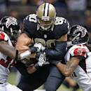 Atlanta Falcons strong safety Kemal Ishmael (36) strips the football from New Orleans Saints tight end Jimmy Graham (80) after a reception near the goal line in the second half of an NFL football game in New Orleans, Sunday, Dec. 21, 2014. Falcons free safety Dezmen Southward (41) tackles. (AP Photo/Rogelio Solis)