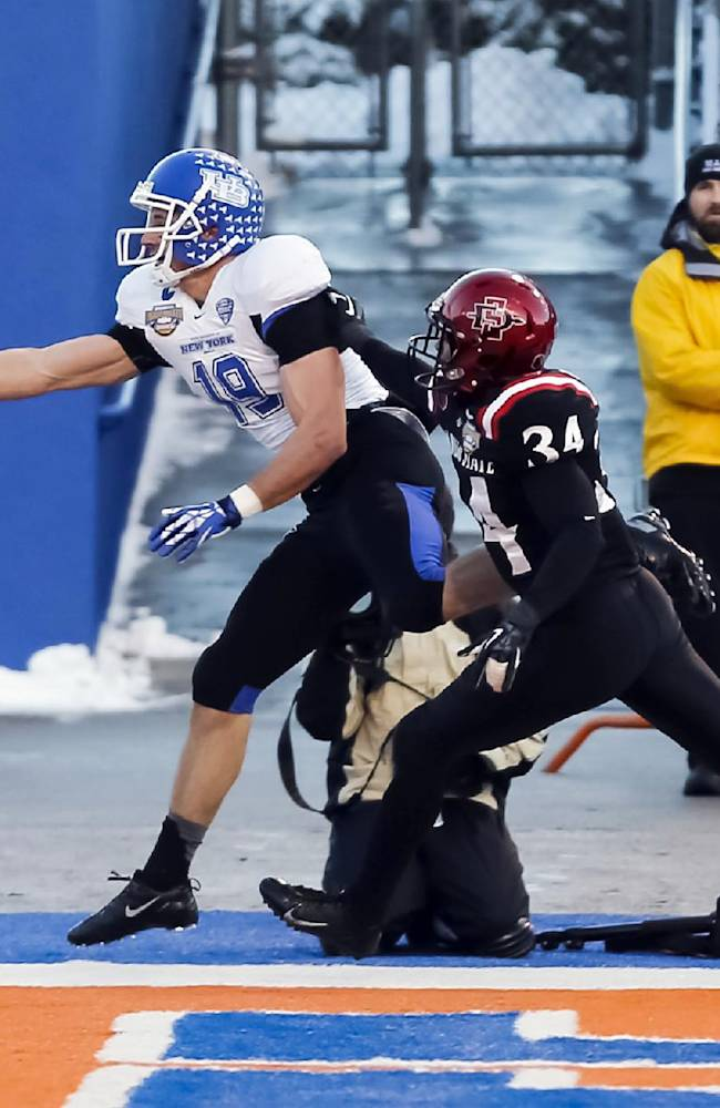 Buffalo wide receiver Alex Neutz (19) just misses catching a touchdown pass in front of San Diego State defensive back J.J. Whittaker (34) during the first half of the Famous Idaho Potato Bowl NCAA college football game against San Diego State in Boise, Idaho, on Saturday, Dec. 21, 2013. San Diego State won 49-24