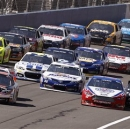 Drivers take a restart after a caution flag during the NASCAR Sprint Cup Series auto race in Fontana, Calif., Sunday, March 24, 2013. (AP Photo/Reed Saxon)
