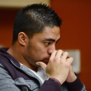 In a photo provided by ESPN, Notre Dame linebacker Manti Te'o pauses during an interview with ESPN on Friday, Jan. 18, 2013, in Bradenton, Fla. ESPN says Te'o maintains he was never involved in creating the dead girlfriend hoax. He said in the off-camera interview: