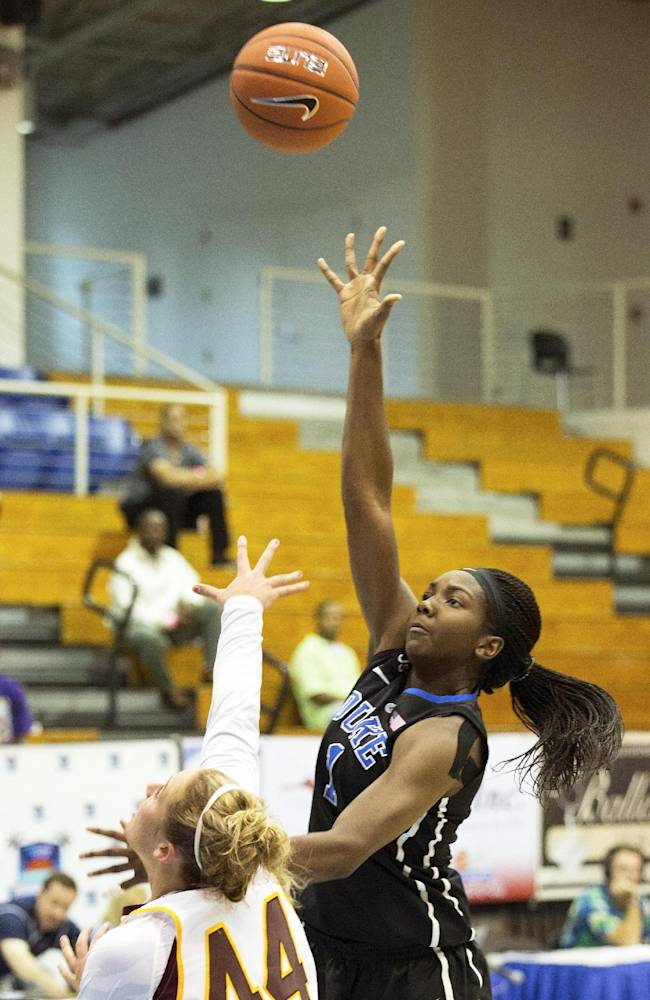 Duke's Elizabeth Williams, right, shoots over Central Michigan's Taylor Johnson during the second half of an NCAA college basketball game in St. Thomas, U.S. Virgin Islands, Friday, Nov. 29, 2013. Duke won 97-64