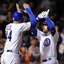 Chicago Cubs' Mike Olt right, celebrates with Anthony Rizzo at home plate after hitting a two-run home run during the fifth inning of a baseball game against the Pittsburgh Pirates in Chicago, Wednesday, April 9, 2014 The Associated Press