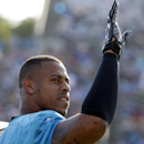 Carolina Panthers' Greg Hardy waves to a fan during NFL football practice at training camp in Spartanburg, S.C., Saturday, July 26, 2014. (AP Photo/Chuck Burton)