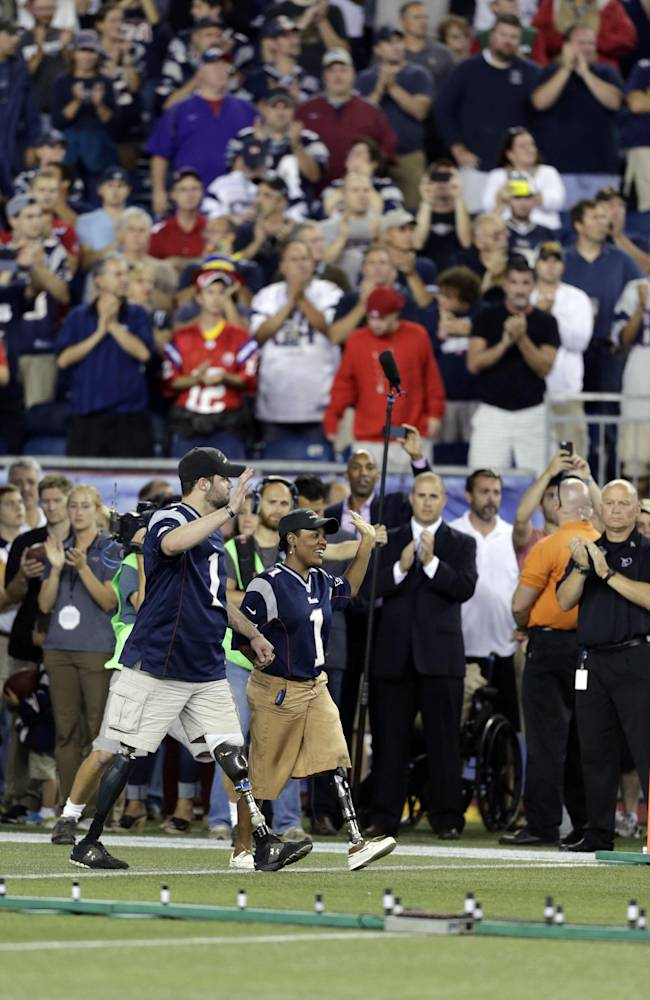 Survivors who lost limbs in the Boston Marathon bombing are honored on the field before an NFL football game between the New England Patriots and the New York Jets on Thursday, Sept. 12, 2013, in Foxborough, Mass