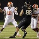 Clemson's Tajh Boyd (10) throws a pass under pressure from Wake Forest's Hasan Hazime (96) during the first half of an NCAA college football game in Winston-Salem, N.C., Thursday, Oct. 25, 2012. (AP Photo/Chuck Burton)