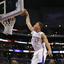 Los Angeles Clippers forward Blake Griffin dunks over Oklahoma City Thunder's Russell Westbrook, left, and Reggie Jackson during the first half of an NBA basketball game in Los Angeles, Wednesday, April 9, 2014 The Associated Press