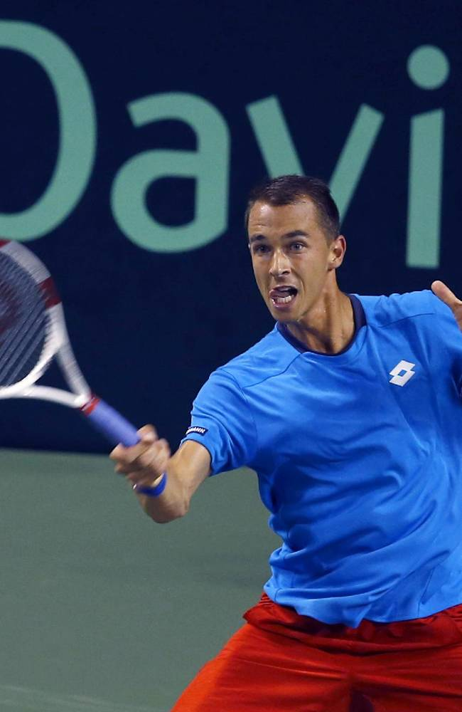 Lukas Rosol of the Czech Republic returns a shot to Taro Daniel of Japan during their quarterfinal of Davis Cup World Group tennis at Ariake Colosseum in Tokyo, Friday, April 4, 2014