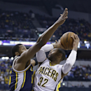 Indiana Pacers guard C.J. Watson, right, looks for a shot over Utah Jazz center Derrick Favors during the first half of an NBA basketball game in Indianapolis, Sunday, March 2, 2014 The Associated Press