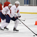 Washington Capitals center Nicklas Backstrom, of Sweden, skates with the puck during NHL hockey training camp, Friday, Sept. 19, 2014, in Arlington, Va The Associated Press
