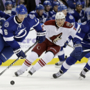 Tampa Bay Lightning defenseman Anton Stralman (6), of Sweden, caries the puck around Arizona Coyotes left wing Rob Klinkhammer (36) and Lightning center Valtteri Filppula (51), of Finland, during the first period of an NHL hockey game Tuesday, Oct. 28, 20