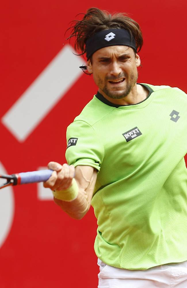 David Ferrer of Spain returns the ball to Fabio Fognini of Italy during the final match of the Buenos Aires' Copa Claro tennis Open in Buenos Aires, Argentina,  Sunday, Feb. 16, 2014