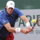 John Isner of the U.S. returns against compatriot Ryan Harrison in their second round match at the French Open tennis tournament, at Roland Garros stadium in Paris, Friday, May 31, 2013. (AP Photo/Michel Euler)