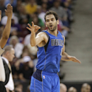 Dallas Mavericks guard Jose Calderon, of Spain, flashes three fingers after hitting a 3-point basket during the third quarter of the Mavericks' 93-91 win over the Sacramento Kings in an NBA basketball game, Sunday, April 6, 2014, in Sacramento, Calif The