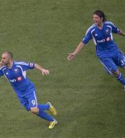 Montreal Impact's Marco Di Vaio, left, turns away to celebrate his game-tying goal against Toronto FC as teammate Daniele Paponi pursues during second-half MLS soccer game action in Toronto, Wednesday, July 3, 2013. (AP Photo/The Canadian Press, Chris Young)