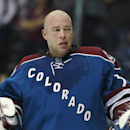 Colorado Avalanche goalie Jean-Sebastien Giguere takes off his helmet during a timeout in the third period of the Anaheim Ducks' 6-4 victory in an NHL hockey game in Denver on Friday, March 14, 2014 The Associated Press