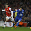 Arsenal's Jack Wilshere, left challenges Everton's Bryan Oviedo during the English Premier League soccer match between Arsenal and Everton at the Emirates Stadium in London, Sunday, Dec. 8, 2013