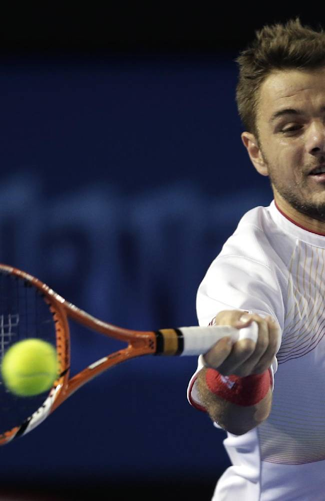 Stanislas Wawrinka of Switzerland makes a forehand return to Tommy Robredo of Spain during their fourth round match at the Australian Open tennis championship in Melbourne, Australia, Sunday, Jan. 19, 2014