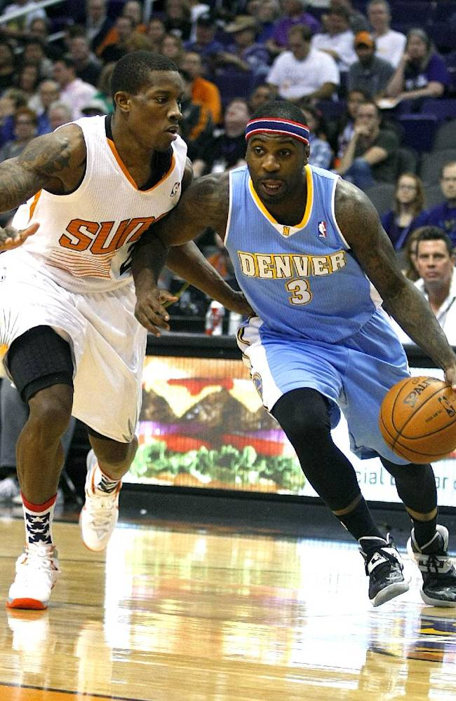 Denver Nuggets point guard Ty Lawson (3), right, drives past Phoenix Suns point guard Eric Bledsoe (2) in the first quarter during an NBA basketball game on Friday, Nov. 8, 2013, in Phoenix