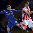 Rochdale's Matt Done, left, and Stoke City's Ryan Shawcross in action to control the ball during their English FA Cup Fourth Round soccer match at Spotland Stadium, in Rochdale, England, Monday Jan. 26, 2015. (AP Photo / Martin Rickett, PA)