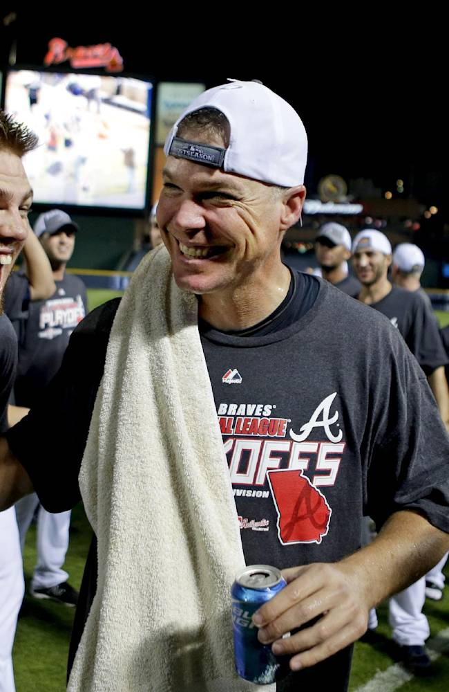 Atlanta Braves' Chipper Jones, right, celebrates with teammate Freddie Freeman after the Braves beat the Miami Marlins 4-3 in a baseball game to clinch the wild card Tuesday, Sept. 25, 2012, in Atlanta