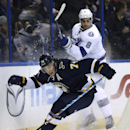 St. Louis Blues' T.J. Oshie, front, chases a puck behind the net as Tampa Bay Lightning's Mark Barberio watches during the second period of an NHL hockey game Tuesday, Feb. 3, 2015, in St. Louis The Associated Press