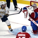 Montreal Canadiens goalie Carey Price (31) stops a shot in front of Nashville Predators' Colin Wilson (33) during the first period of an NHL hockey game Tuesday, Jan. 20, 2015, in Montreal The Associated Press