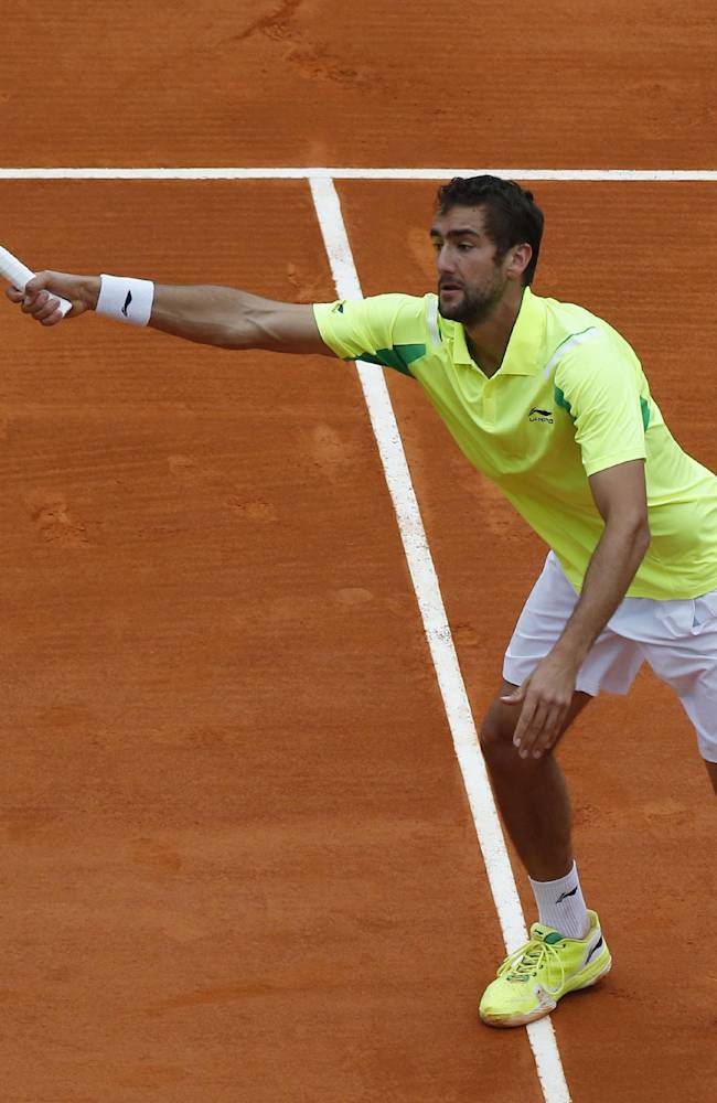 Marin Cilic of Croatia returns the ball to Stanislas Wawrinka of Switzerland during their match of the Monte Carlo Tennis Masters tournament in Monaco, Wednesday, April 16, 2014. Wawrinka won 6-0 6-2