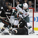 Minnesota Wild defenseman Ryan Suter (20) battles Anaheim Ducks center Andrew Cogliano, seated on ice, and right wing Daniel Winnik (34) for the puck in the first period of an NHL hockey game Wednesday, Dec. 11, 2013 in Anaheim, Calif The Associated Press