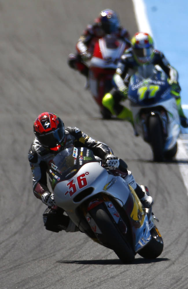 Moto 2 rider Mika Kallio of Finland leads the race followed by Dominique Aegerter of Switzerland and Jonas Folger of Germany during the Spain's Motorcycle Grand Prix at the Jerez race track on Sunday, May 4, 2014 in Jerez de la Frontera, southern Spain