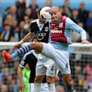 Aston Villa's Karim El Ahmadi, right, and Southampton's Morgan Schneiderlin contest the ball during the English Premier League soccer match between Aston Villa and Southampton at Villa Park, in Birmingham, England, Saturday, April 19, 2014